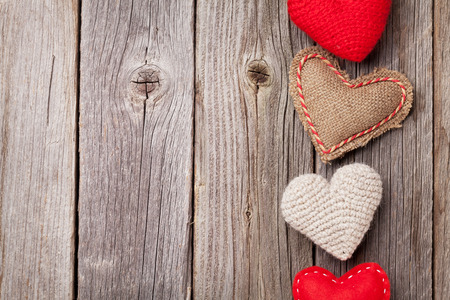 Valentines day toy hearts on wooden table with copy space