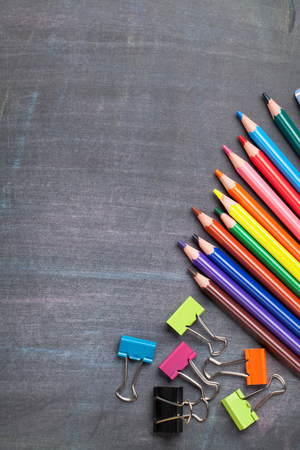 creativity concept: School and office supplies on blackboard background. Top view with copy space