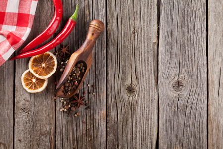trompo de madera: Spices on wooden table. Top view with copyspace