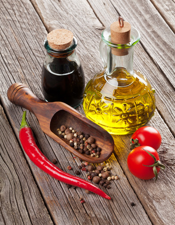 cooking oil: Spices and condiments on wooden table Stock Photo