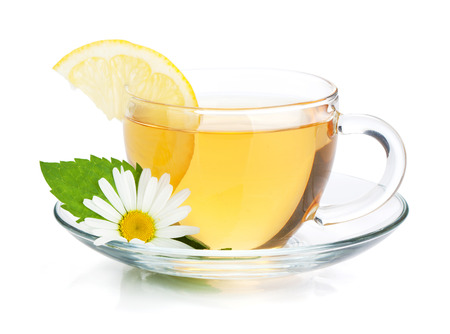 cup of tea: Cup of tea with lemon slice, mint leaves and chamomile flower. Isolated on white background