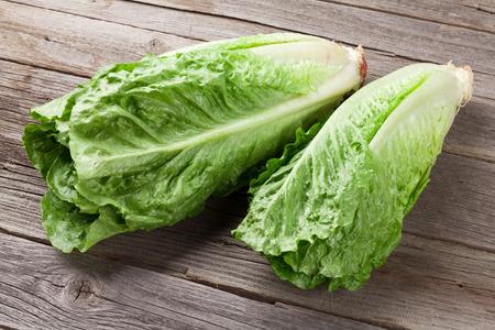 Fresh Romano salad on wooden table Standard-Bild