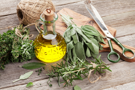 aromatic: Fresh garden herbs and condiments on wooden table