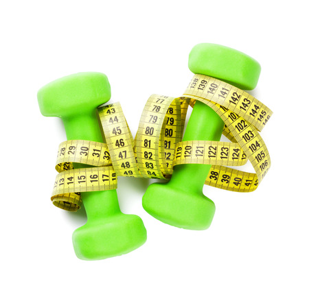 Dumbbells and tape measure. Isolated on white background Stock Photo