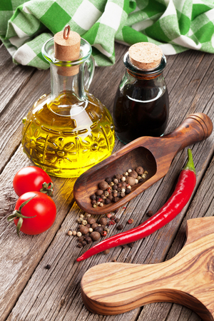 condiments: Spices and condiments on wooden table Stock Photo