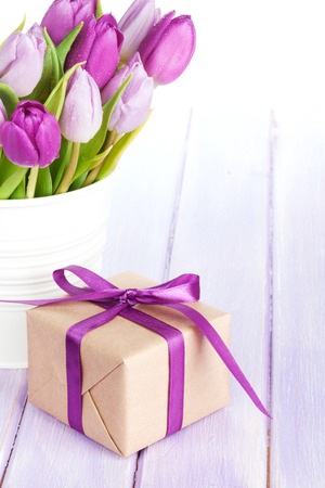 pink tulips: Purple tulip bouquet and gift box on wooden table with copy space