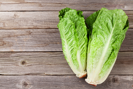 lettuce: Fresh Romano salad on wooden table. Top view with copy space