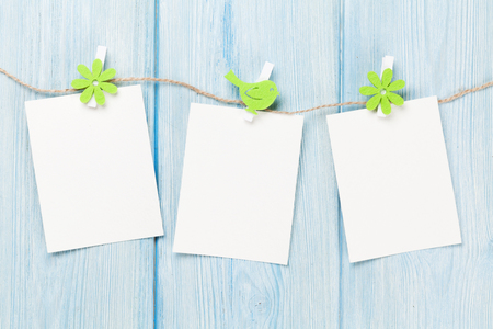 blank photo: Easter blank photo frames over wood background