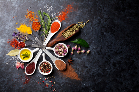 Herbs and spices over black stone background. Top view with copy space Reklamní fotografie - 51528610