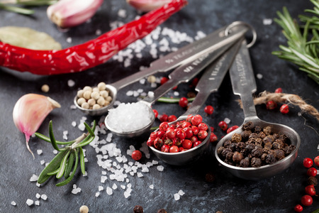 chili powder: Herbs and spices over black stone background Stock Photo