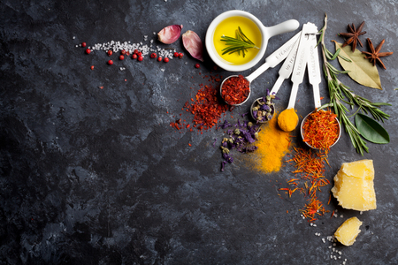 stone: Herbs and spices over black stone background. Top view with copy space