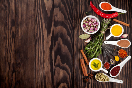 chili powder: Herbs and spices over wood background. Top view with copy space Stock Photo