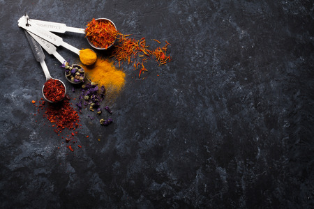 Colorful spices on stone table. Top view with copy space Archivio Fotografico