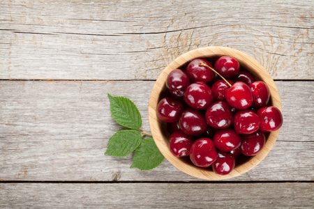 cherry: Ripe cherries on wooden table. View from above with copy space