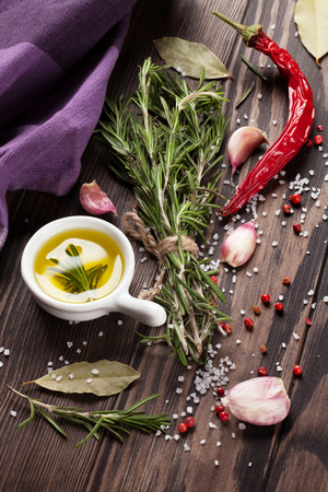 seasoning: Herbs and spices over wood background Stock Photo