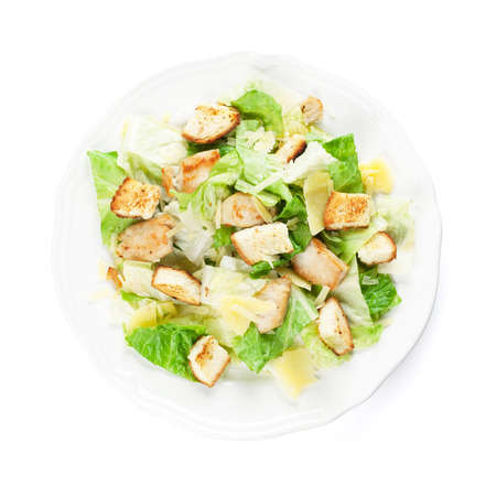 Fresh healthy caesar salad. Isolated on white background. Top view