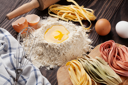 homemade: Homemade pasta cooking on wooden table Stock Photo
