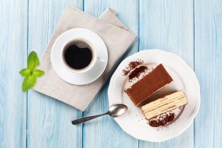 tiramisu: Tiramisu dessert and coffee on wooden table. Top view