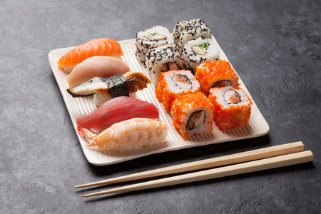 table set: Set of sushi and maki roll on stone table