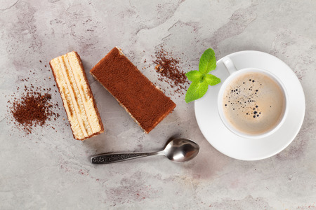 Tiramisu dessert and coffee on stone table. Top view