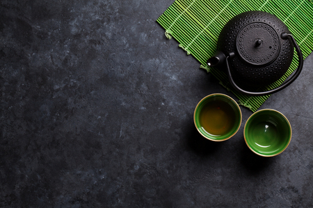 rustic food: Green japanese tea on stone table. Top view with copy space