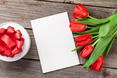 valentines gift: Red tulips, gift box and Valentines day greeting card. Top view with copy space Stock Photo
