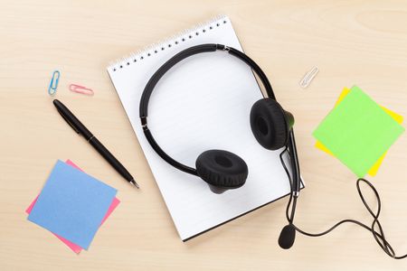 top veiw: Office desk with headset and supplies. Call center table. Top veiw with copy space Stock Photo