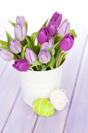 copies: Purple tulip bouquet and easter eggs on wooden table