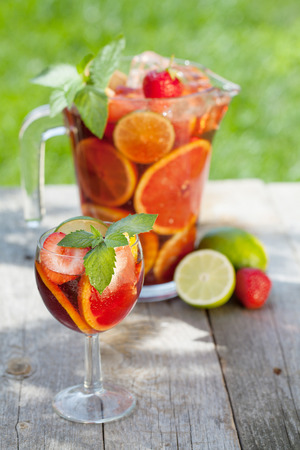 Refreshing fruit sangria (punch) on wood table Stock Photo
