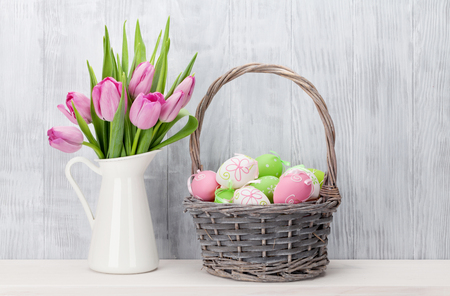 egg plant: Easter eggs in basket and tulips on shelf in front of wooden wall