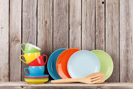 utensils: Kitchen utensils on shelf against rustic wooden wall