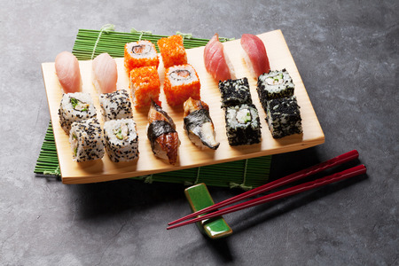 black stone: Set of sushi and maki roll on stone table