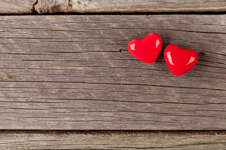 two on top: Two candy hearts over wood. Valentines day background. Top view with copy space