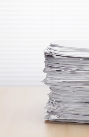 paper stack: Stack of paper documents on office table Stock Photo