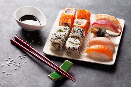 eel: Set of sushi and maki roll on stone table