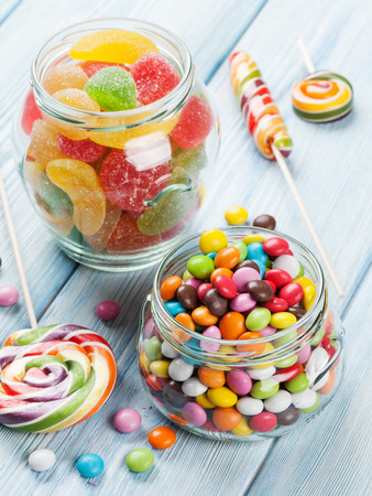 chocolate candy: Colorful candies on wooden table background Stock Photo