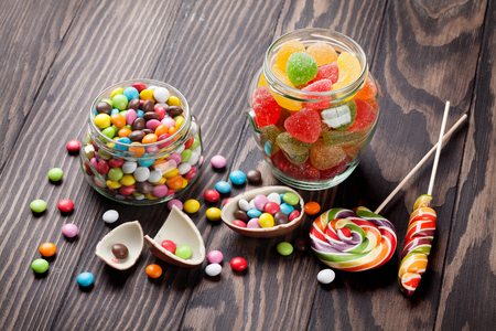 marmalade: Colorful candies on wooden table background Stock Photo