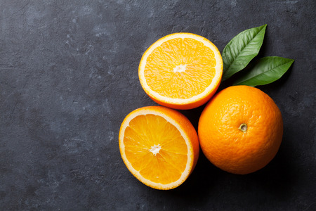 ripe: Fresh ripe oranges on dark stone background. Top view with copy space Stock Photo