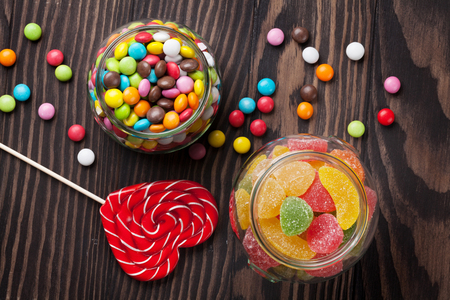 marmalade: Colorful candies on wooden table background. Top view