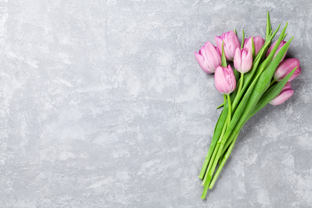 Fresh pink tulip flowers on stone table. Top view with copy space Imagens - 55372760