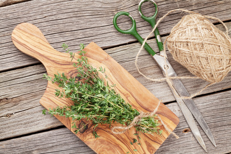 aromatic: Bunch of garden thyme herb on wooden table