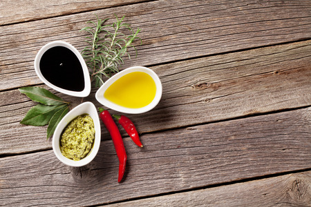seasoning: Herbs, condiments and spices on wooden background. Top view with copy space Stock Photo