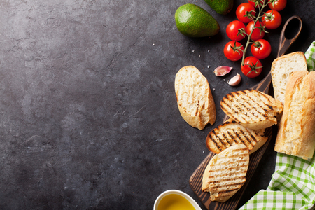 black stone: Ciabatta sandwich cooking over stone background. Top view with copy space