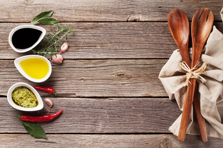 Herbs, condiments and spices on wooden background. Top view with copy space Imagens