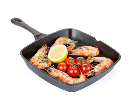 pan: Grilled shrimps on frying pan. Isolated on white background Stock Photo