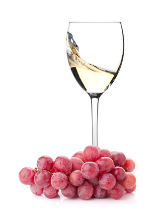 incidence: Splashing white wine in a glass and grapes. Isolated on white background