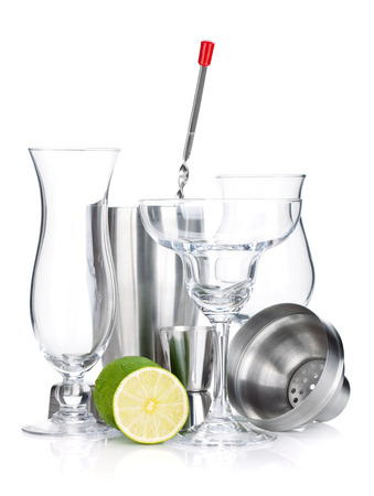 cocktail strainer: Cocktail shakers, glasses, utensils and lime. Isolated on white background Stock Photo