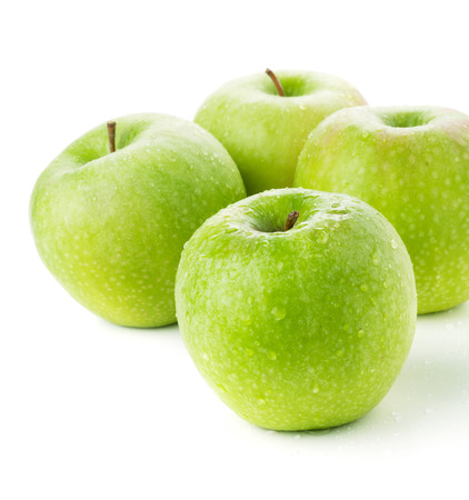 Four ripe green apples. Closeup. Isolated on white