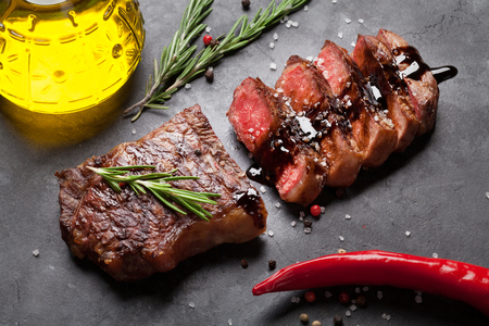 meat grill: Grilled striploin sliced steak over stone table Stock Photo