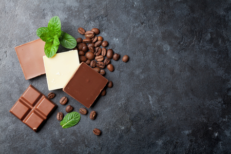 Chocolate and coffee beans on dark stone table. Top view with copy space Stok Fotoğraf - 56448106